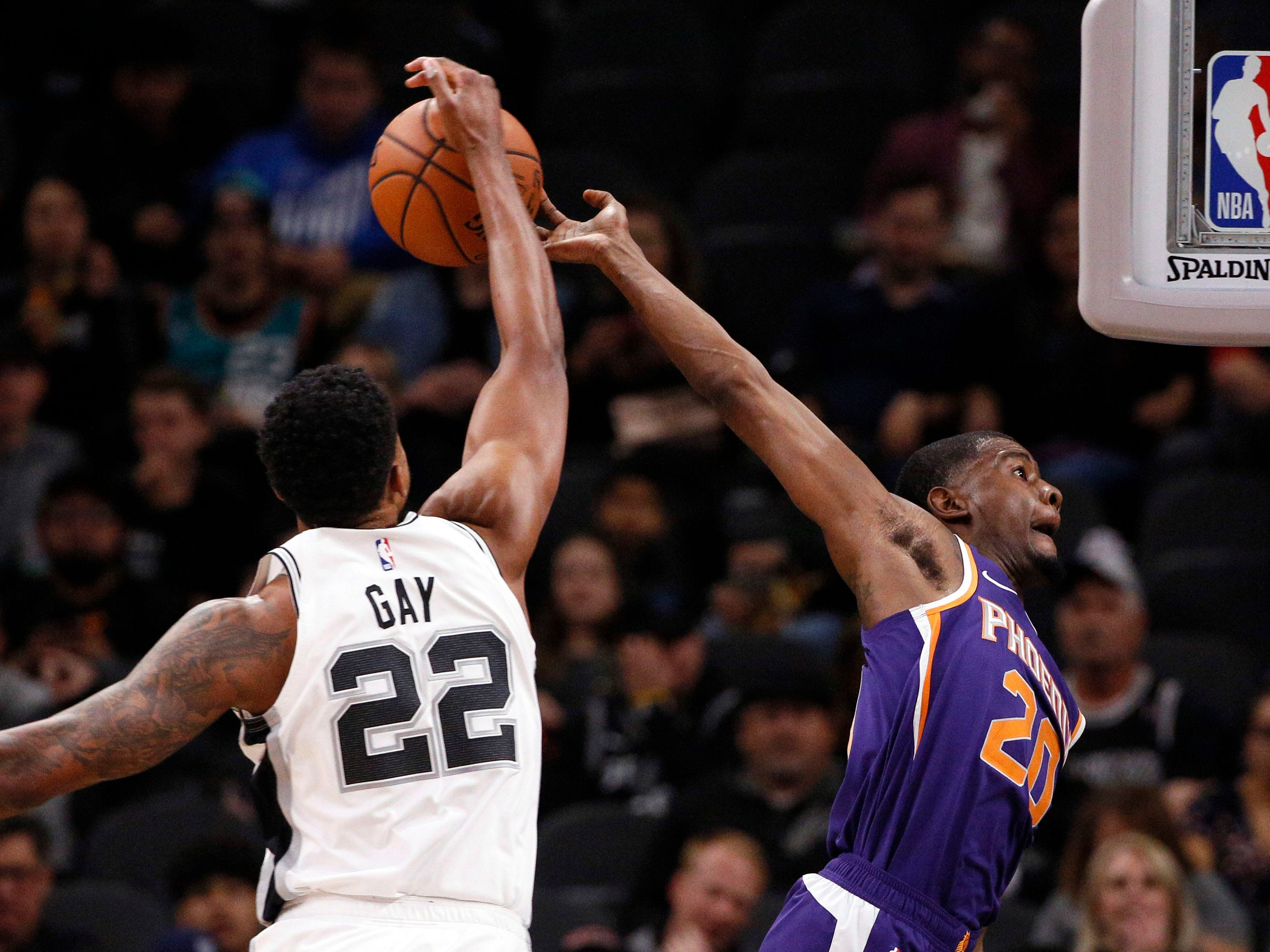 Dec 11, 2018; San Antonio, TX, USA; Phoenix Suns small forward Josh Jackson (20) has his shot blocked by San Antonio Spurs small forward Rudy Gay (22) during the first half at AT&T Center. Mandatory Credit: Soobum Im-USA TODAY Sports