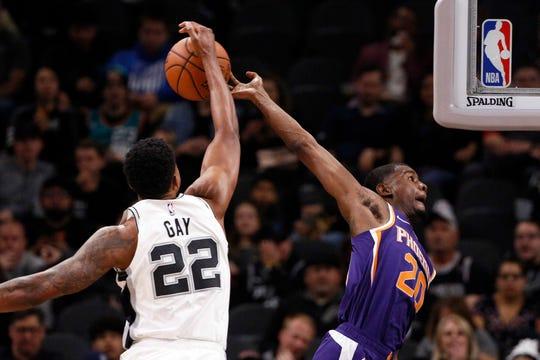 Dec 11, 2018; San Antonio, TX, USA; Phoenix Suns small forward Josh Jackson (20) has his shot blocked by San Antonio Spurs small forward Rudy Gay (22) during the first half at AT&T Center. Mandatory Credit: Soobum Im-USA TODAY Sports