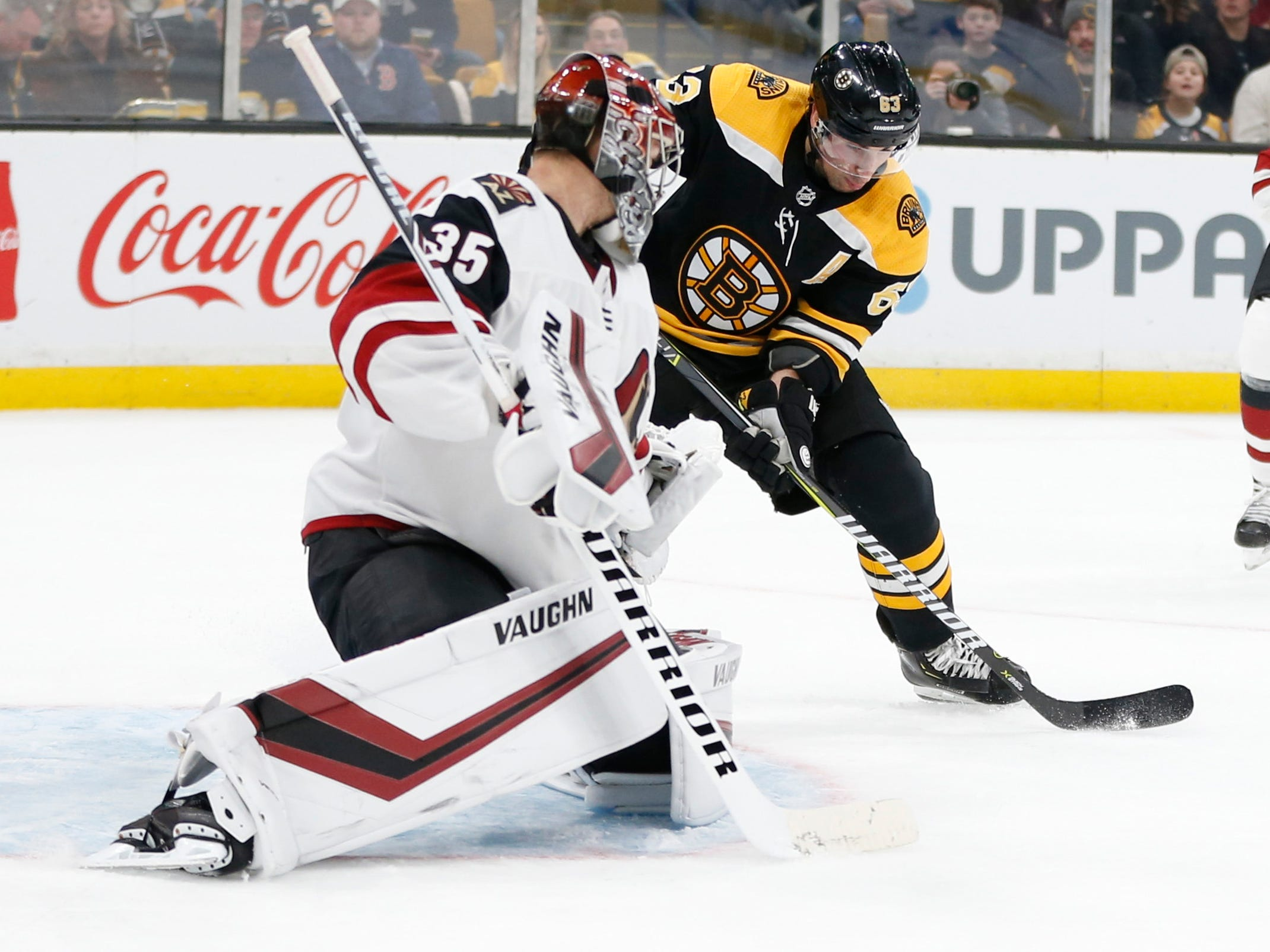 Dec 11, 2018; Boston, MA, USA; Boston Bruins left wing Brad Marchand (63) scores a goal on Arizona Coyotes goaltender Darcy Kuemper (35) during the second period at TD Garden. Mandatory Credit: Greg M. Cooper-USA TODAY Sports
