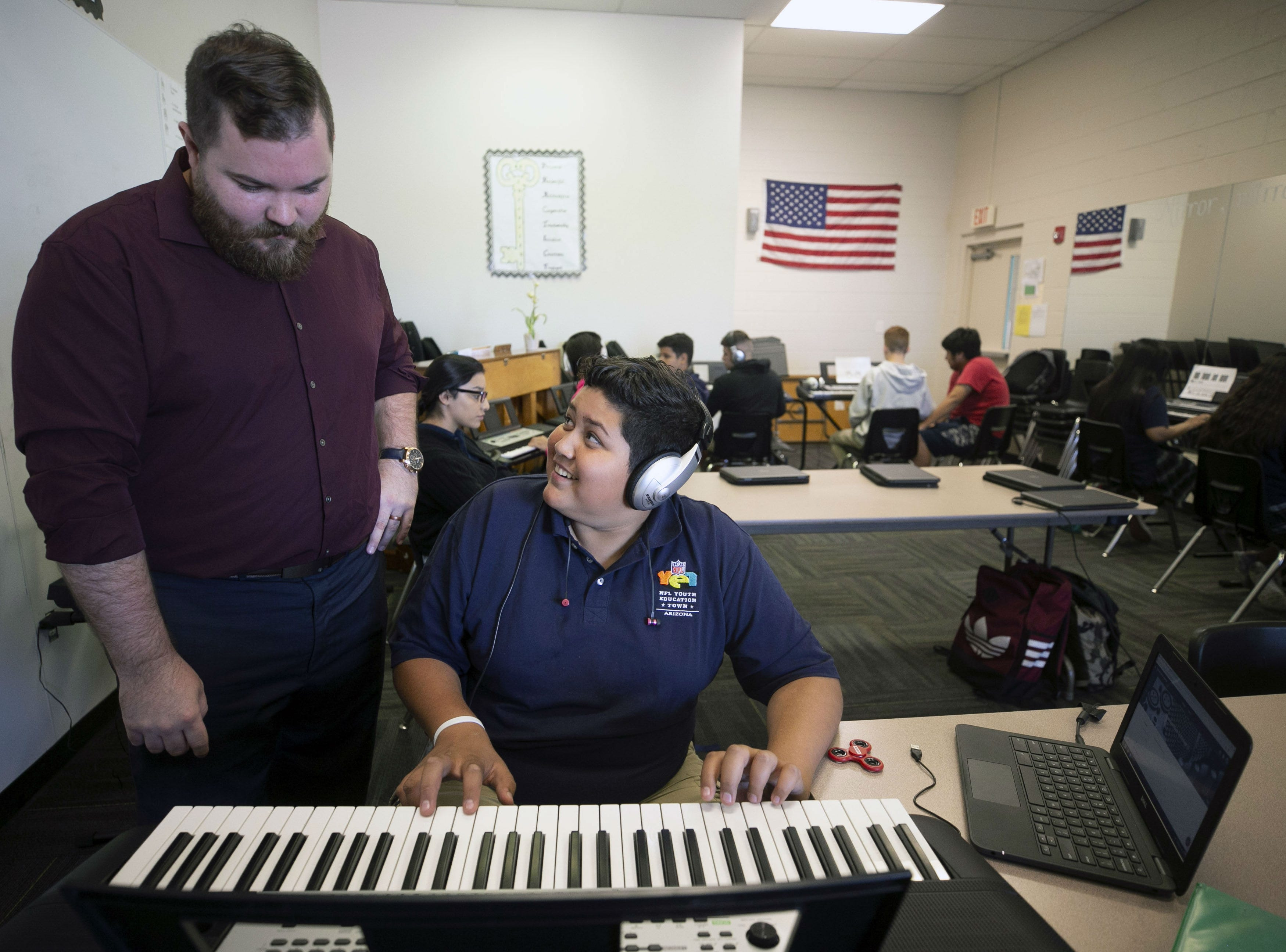 Music teacher Kenny Edmondson works with Jesus Camacho, 15, in music class at the NFL YET College Prep Academy, a seventh-12th grade charter school in south Phoenix, on Nov. 5, 2018.