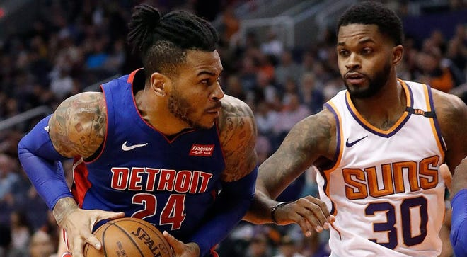 The Suns signed center Eric Moreland, seen here driving against Troy Daniels last season, on Monday.
