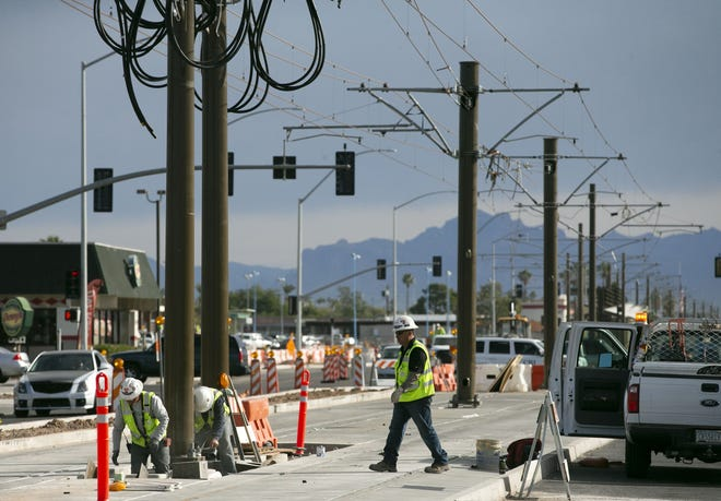 Construction on the light rail extension along Main Street near Stapley Drive in Mesa continues on Tuesday, December 11, 2018.