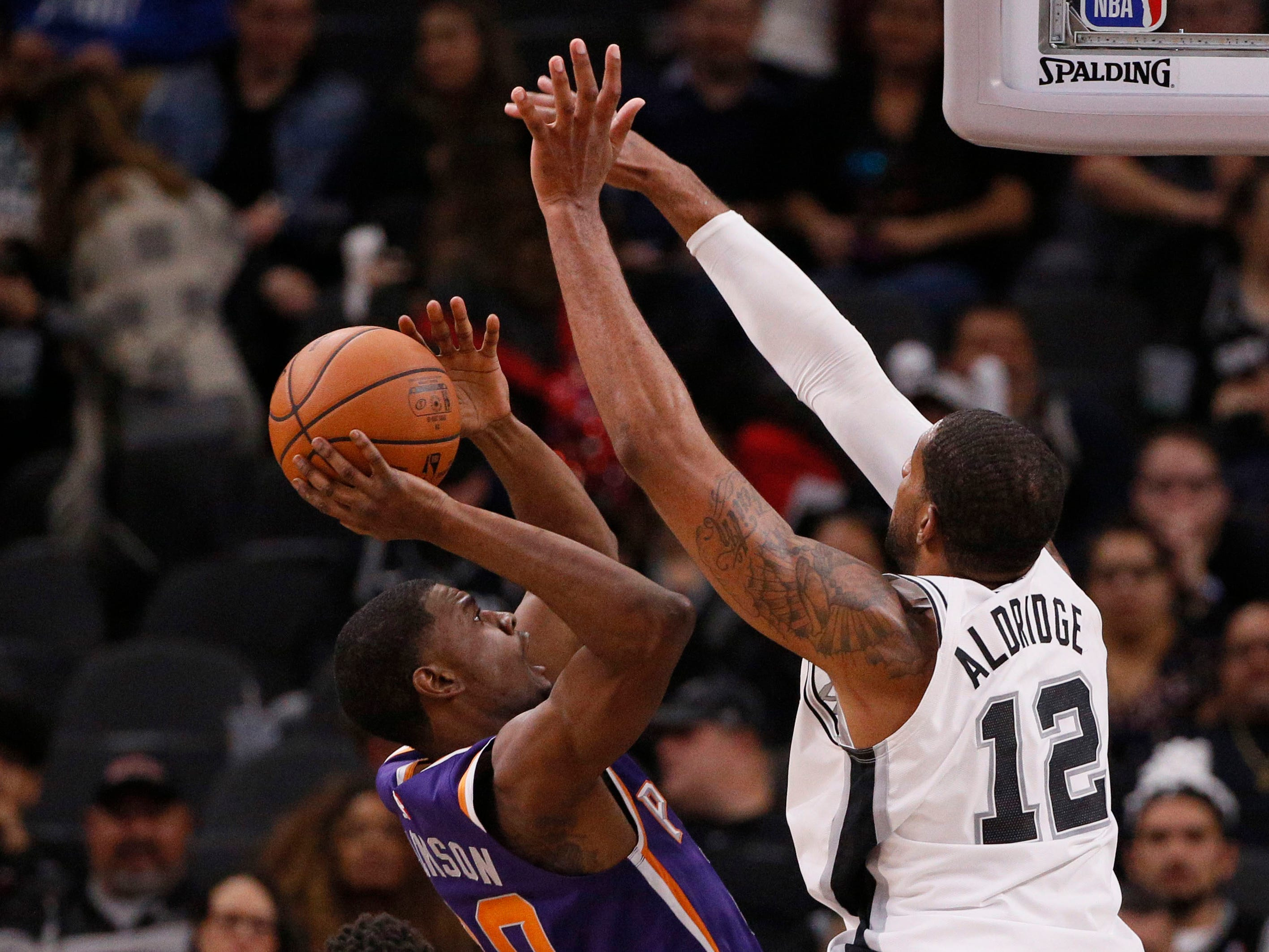 Dec 11, 2018; San Antonio, TX, USA; Phoenix Suns small forward Josh Jackson (left) shoots the ball as San Antonio Spurs power forward LaMarcus Aldridge (12) defends during the first half at AT&T Center. Mandatory Credit: Soobum Im-USA TODAY Sports