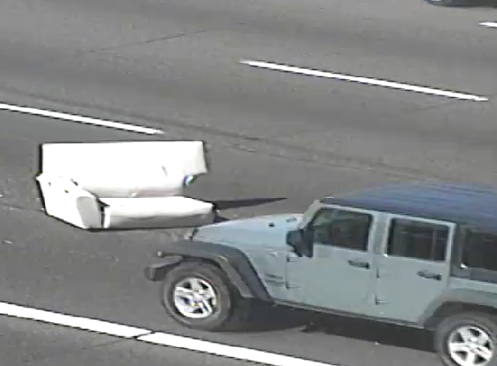 A couch sat between the left and left-center lanes of westbound U.S. 60 near Mesa Drive in 2016.