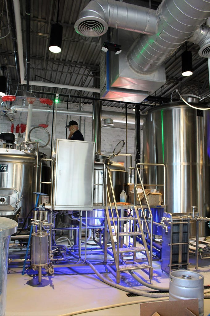 Co-owner and head brewer Steve Stone works on a batch of Smoked Chiptole Porter at Helluva Brewing Company in Chandler.