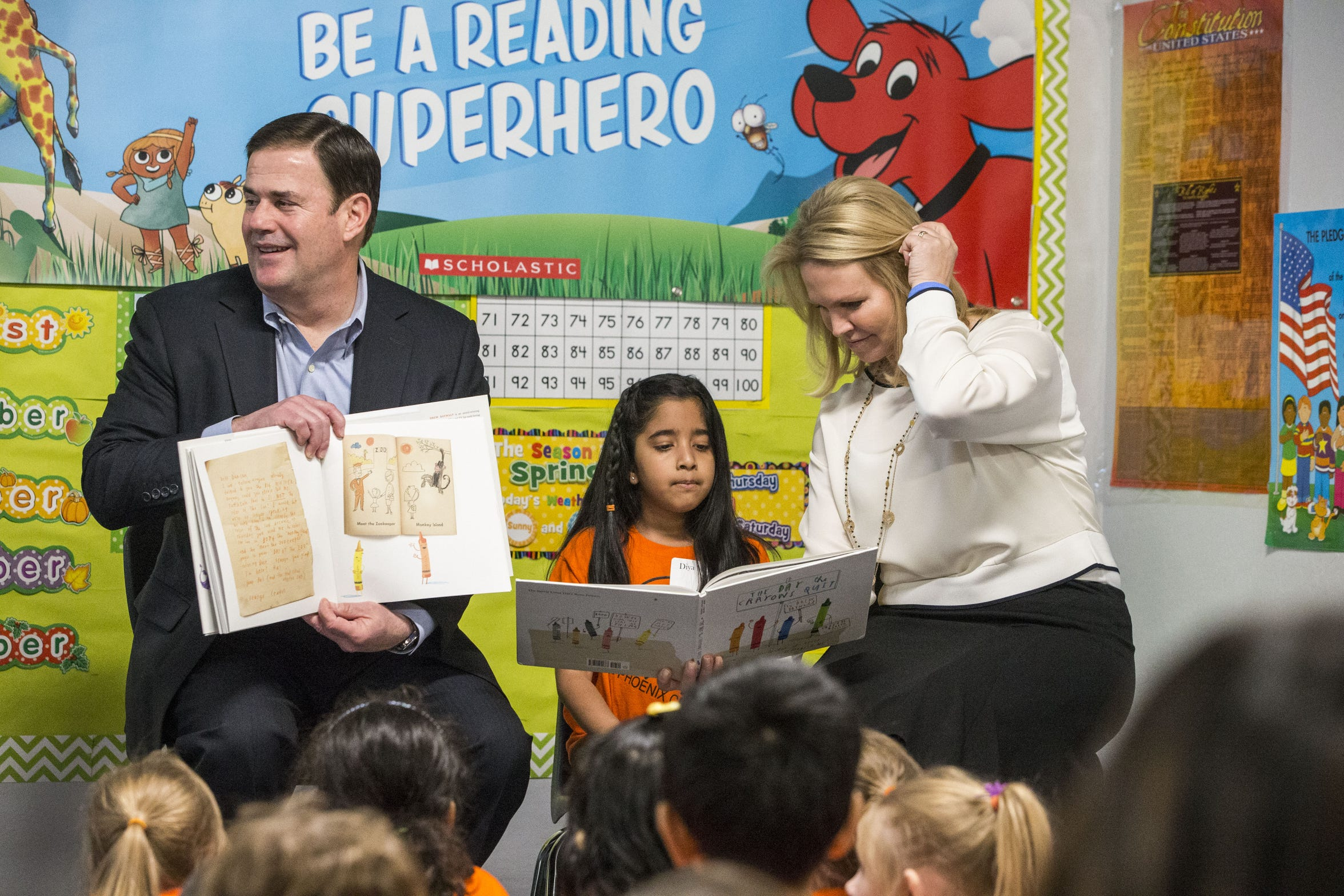Gov. Doug Ducey and his wife, Angela,  read books with students at BASIS Phoenix Central on May 9, 2016.