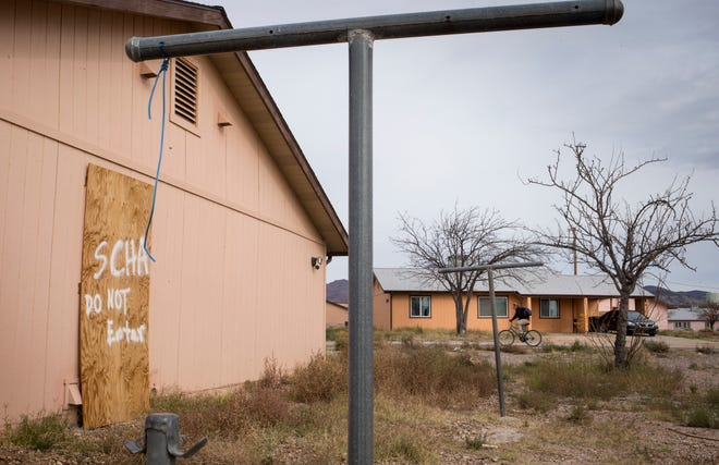 A boarded-up San Carlos Apache Housing Authority home on Dec. 11, 2018, in the Moonbase neighborhood of Peridot.