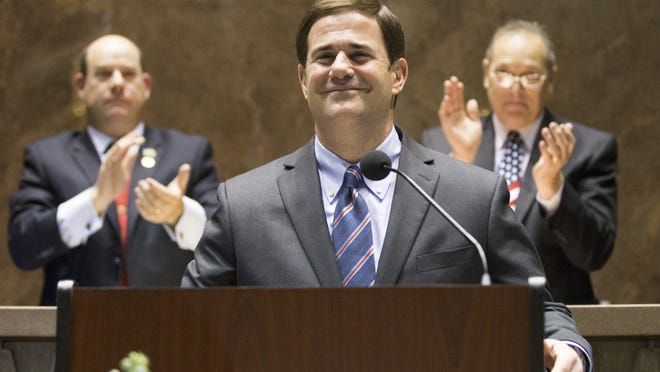 Gov. Doug Ducey is introduced before delivering his first State of the State address in the House chambers Jan. 12, 2015. At left is House Speaker David M. Gowan and at right is Senate President Andy Biggs.