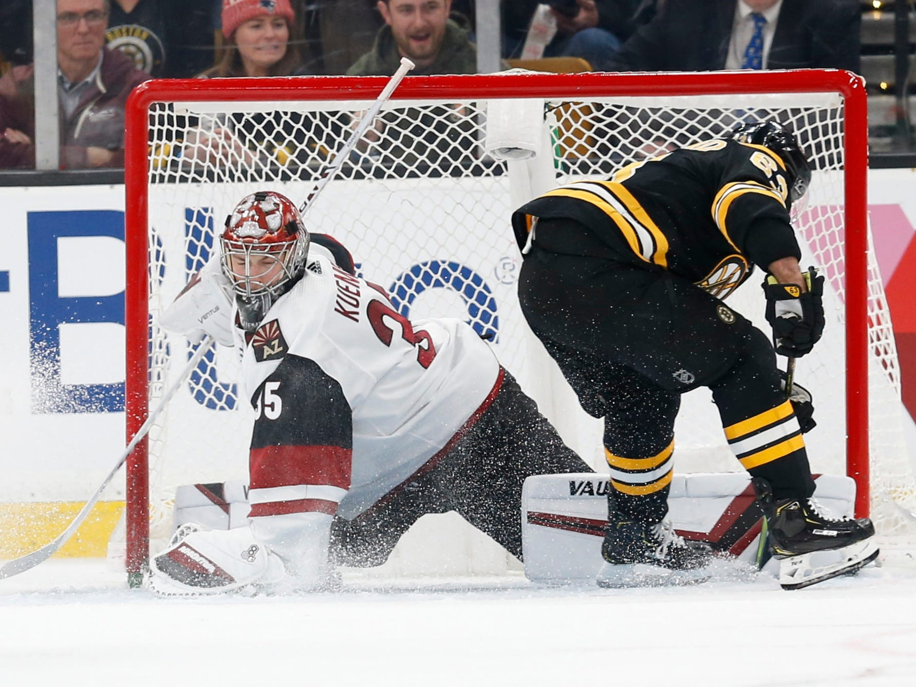 Dec 11, 2018; Boston, MA, USA; Arizona Coyotes goaltender Darcy Kuemper (35) stops a shot by Boston Bruins left wing Brad Marchand (63) during the third period at TD Garden. Mandatory Credit: Greg M. Cooper-USA TODAY Sports