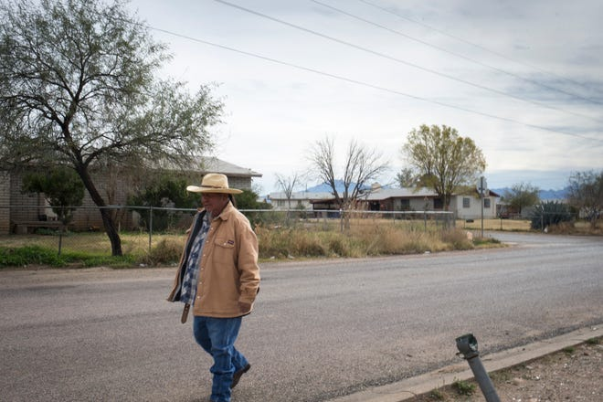 Scotty Rogers walks down the street in the Hallelujah Square neighborhood on Dec. 11, 2018, Peridot.