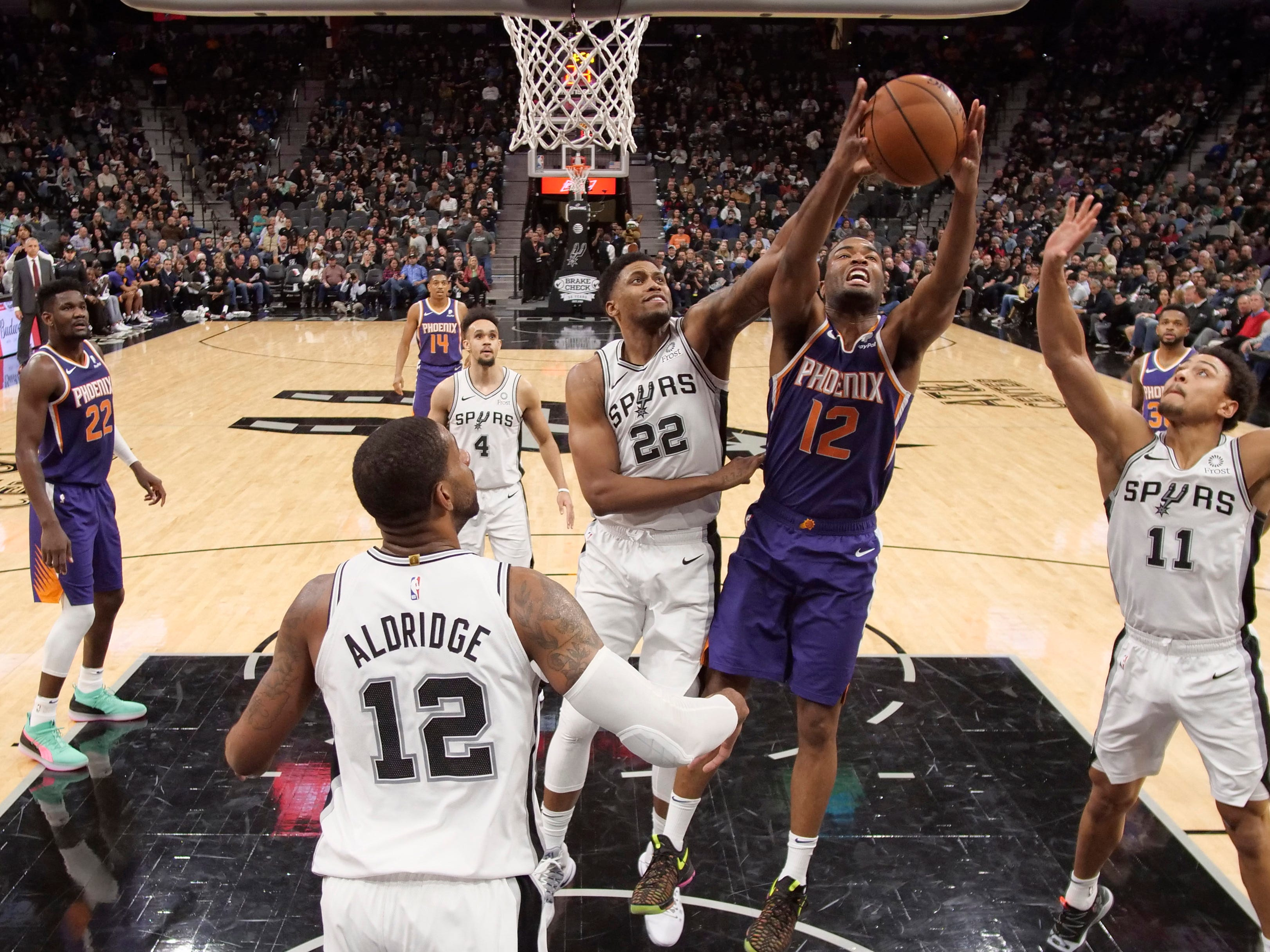 Dec 11, 2018; San Antonio, TX, USA; San Antonio Spurs small forward Rudy Gay (22) and Phoenix Suns small forward T.J. Warren (12) battle for a rebound during the second half at AT&T Center. Mandatory Credit: Soobum Im-USA TODAY Sports