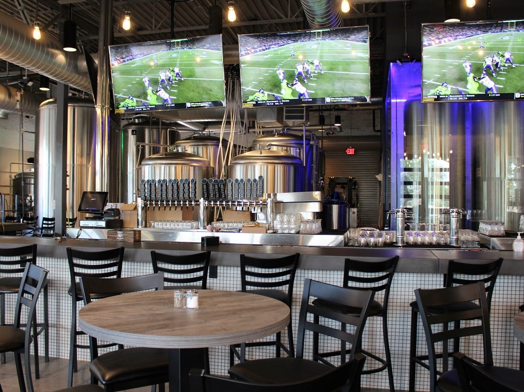 Helluva Brewing Company in Chandler offers 14 75-inch televisions.