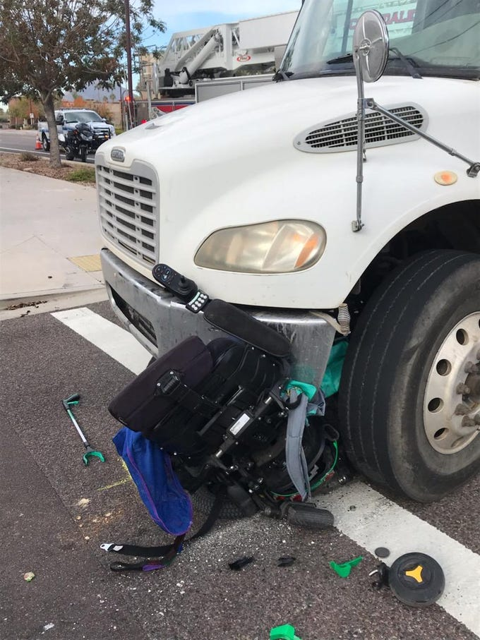 A woman in an electric wheelchair was injured when she was struck by a dump truck near 85th Street and Indian School Road in Scottsdale.