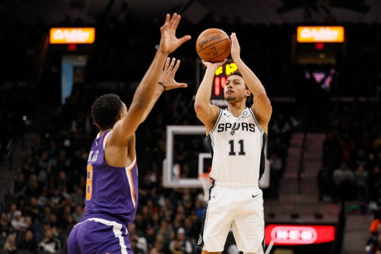 Dec 11, 2018; San Antonio, TX, USA; San Antonio Spurs shooting guard Bryn Forbes (11) shoots the ball over Phoenix Suns small forward George King (8) during the first half at AT&T Center. Mandatory Credit: Soobum Im-USA TODAY Sports