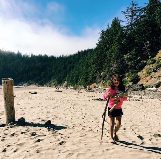 Vida Reyes collects firewood in 2017 near Cannon Beach along the Oregon coast.