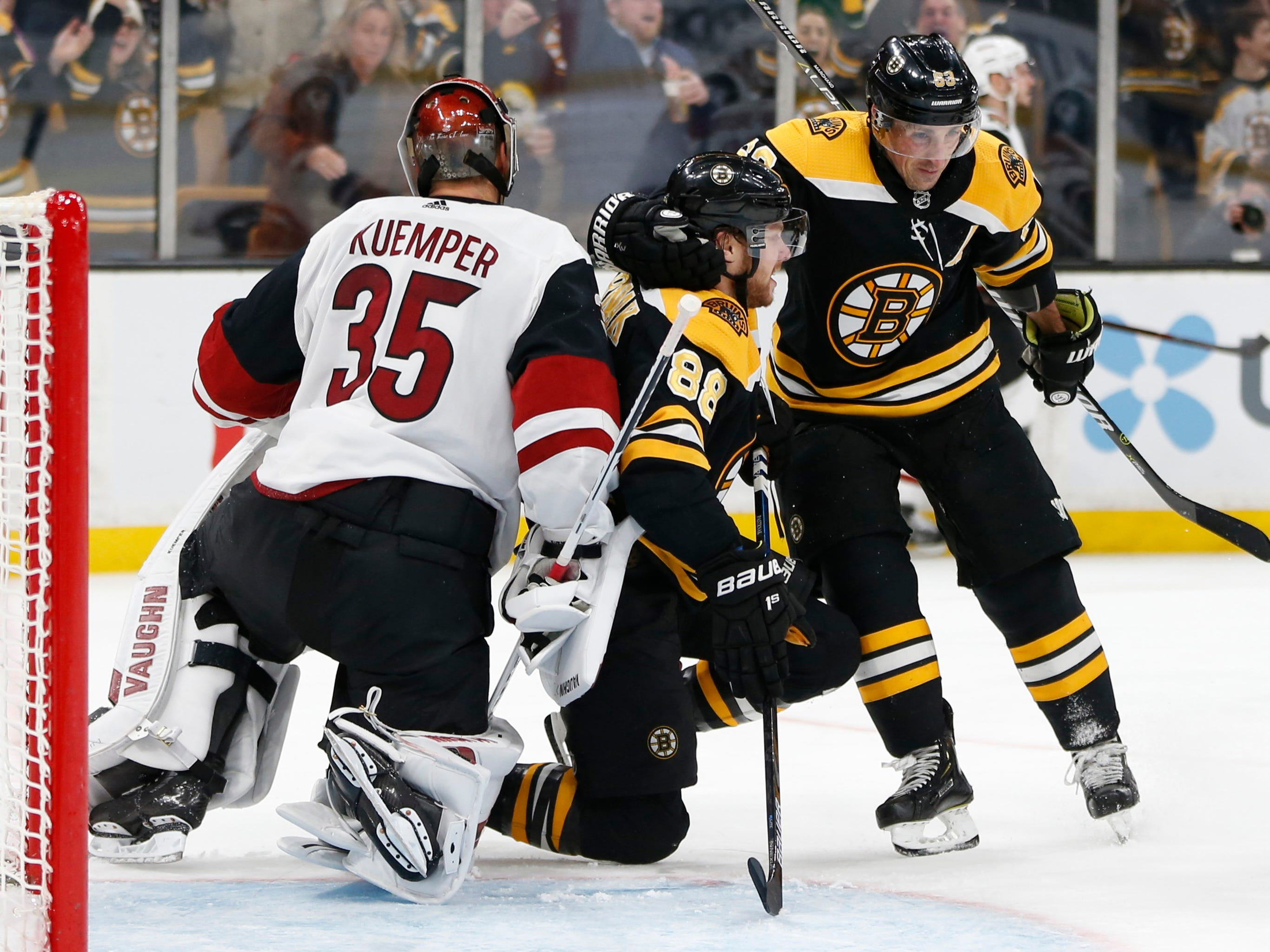 Dec 11, 2018; Boston, MA, USA; Boston Bruins left wing Brad Marchand (63) congratulates right wing David Pastrnak (88) after he scored a goal on Arizona Coyotes goaltender Darcy Kuemper (35) during the second period at TD Garden. Mandatory Credit: Greg M. Cooper-USA TODAY Sports