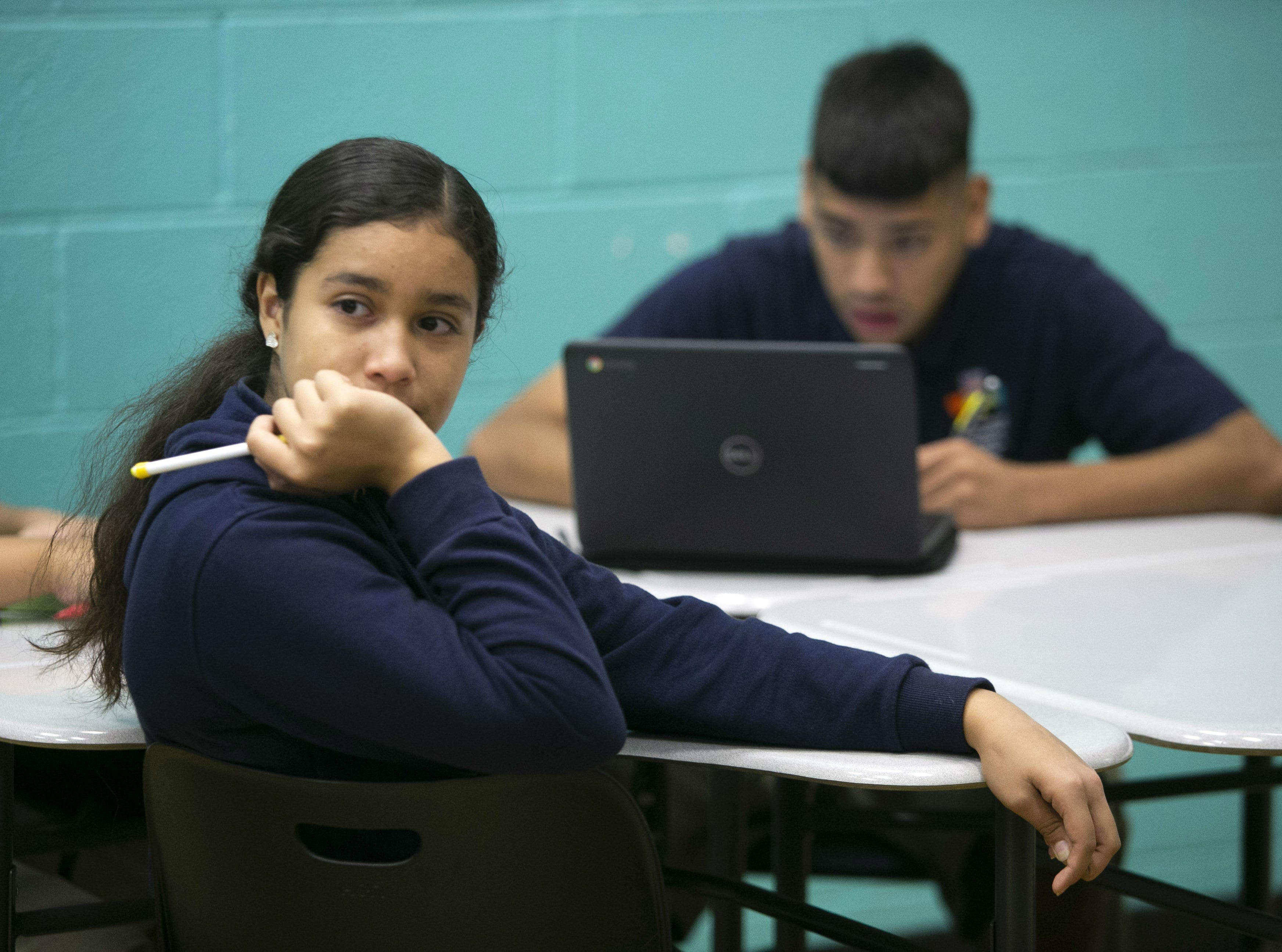 Esmeralda Partida Roja,13, listens during a seventh grade math class at the NFL YET College Prep Academy,  a seventh-12th grade charter school in south Phoenix, on Nov. 5, 2018.