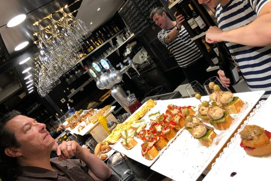 Moments after this photo was taken at Taberna Orhi in San Sebastian, Spain, a bartender dropped a wine glass while grabbing it from the rack overhead. Glass shards landed on the food below. One pintxo was almost grabbed by a customer.
