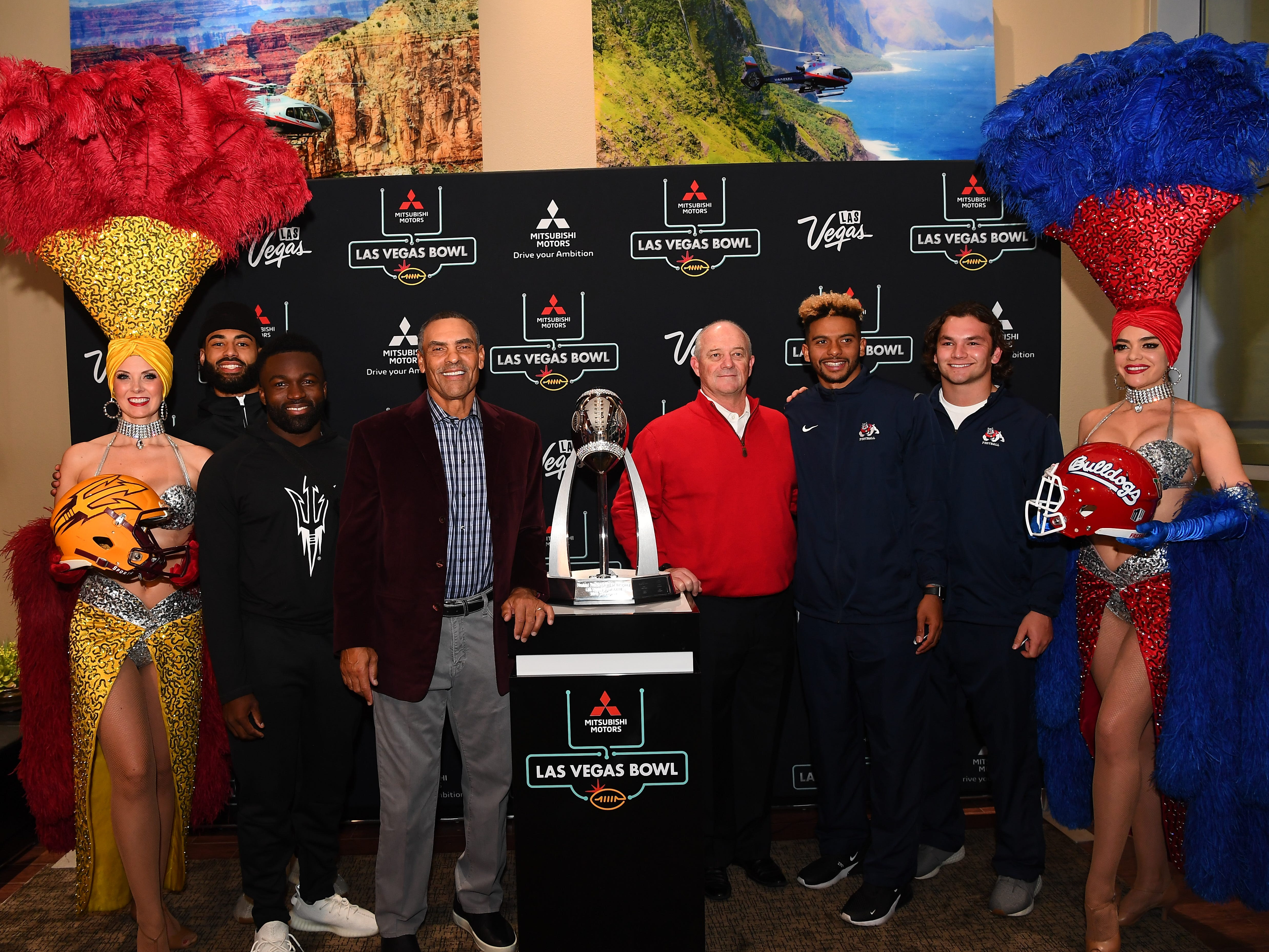 ASU's Manny Wilkins, Eno Williams and Herm Edwards pose with Fresno State's Jeff Tedford, Marcus McMaryion and George Helmuth during a media event in Las Vegas on Tuesday.
