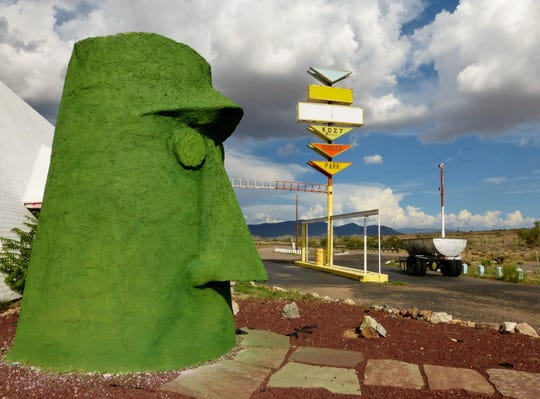 Giganticus Headicus, a 14-foot tall tiki head, located along Route 66 east of Kingman, keeps watch over travelers.