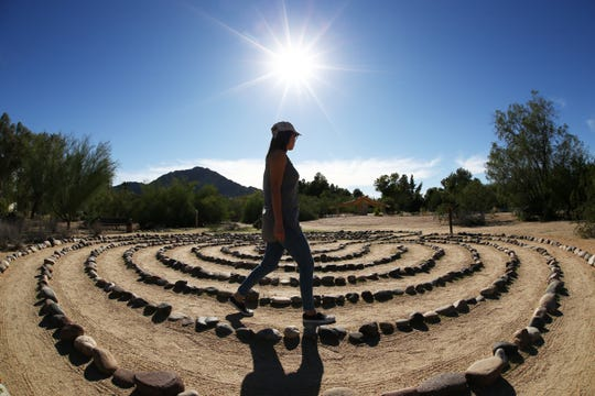 Michelle Spence of Phoenix walks the labyrinth on Oct. 31, 2018 at the Franciscan Renewal Center.