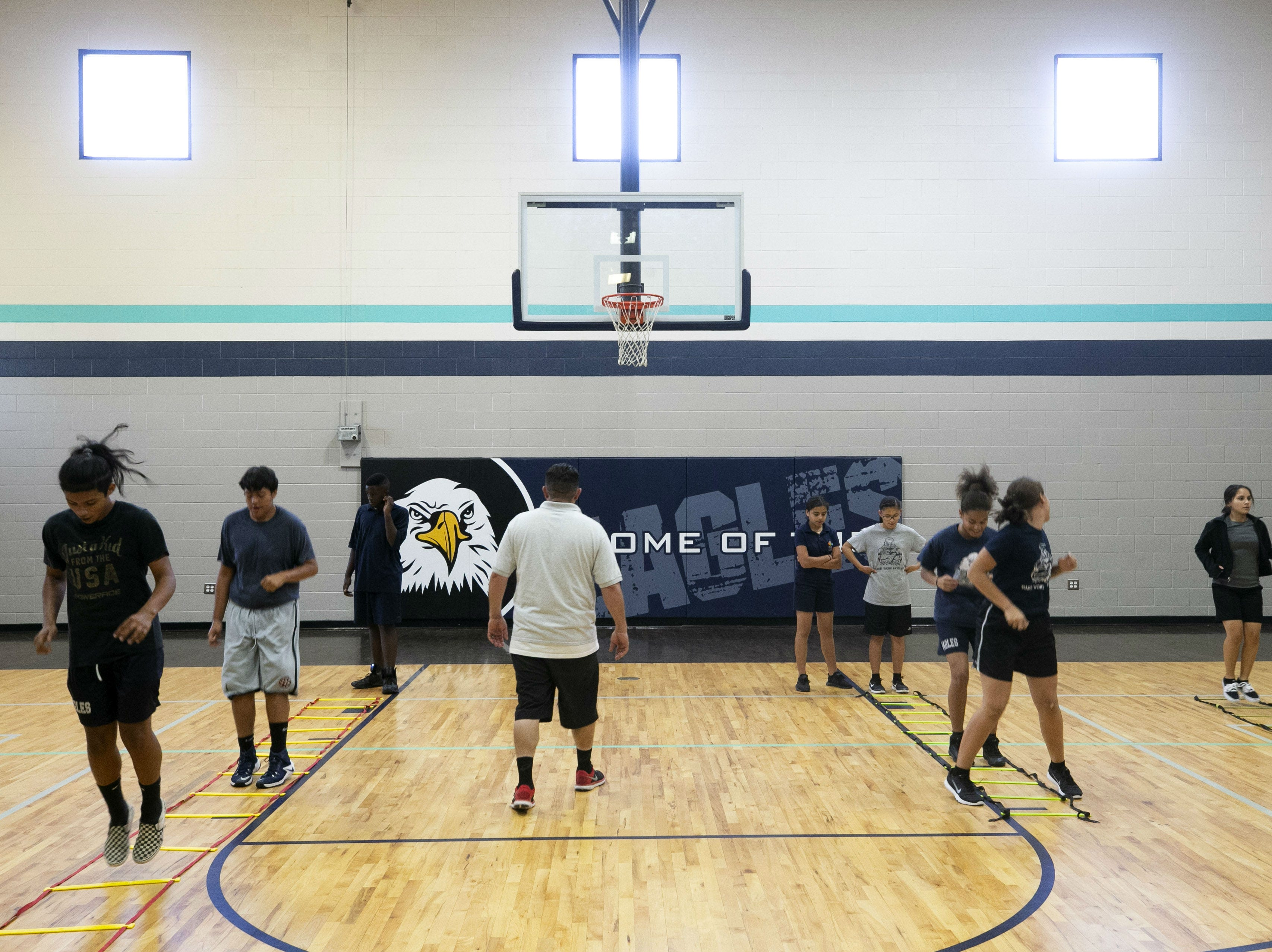 Students participate in a gym class at the NFL YET College Prep Academy a seventh-12th grade charter school in south Phoenix, on Nov. 5, 2018.