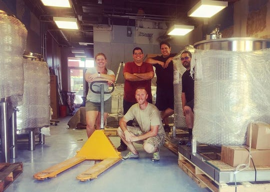 Arturo Ruiz, Daniel Rosales-Yeomans, Jose Hinojosa and husband-and-wife Chris and Sommer Decker own Desert Monks Brewing Co. in Gilbert Town Square.