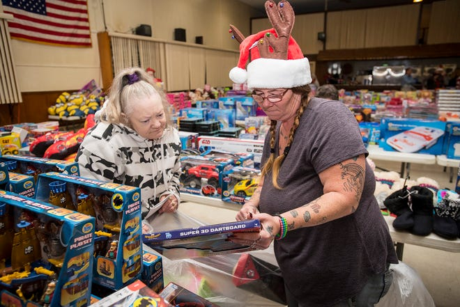 Volunteer Alberta Young, right, helps Rose Bean find toys Wednesday, Dec. 12, 2018 during the annual toy giveaway at the Charles Hammond American Legion Post in Port Huron.
