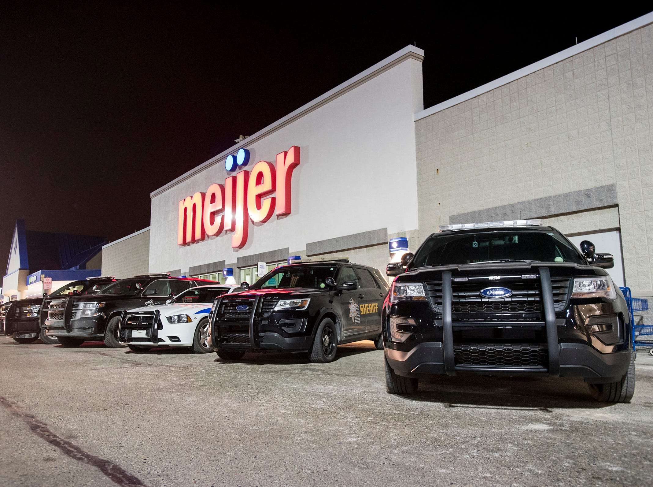 Police vehicles are parked in front of Meijer during Christmas with a Cop Tuesday, Dec. 11, 2018 in Fort Gratiot. This year, 98 kids participated in the event.