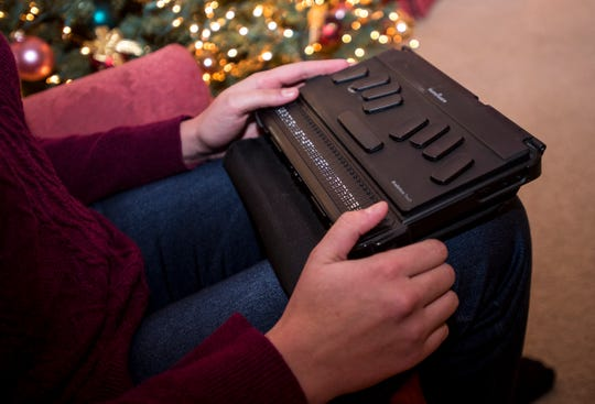 Alexandra Allers works a refreshable Braille reader Wednesday, Dec. 13, 2018 in her family's Fort Gratiot home. Allers was given the 2019 Yes I Can Award by the Council for Exceptional Children for a video she made talking about the technology she uses at school.