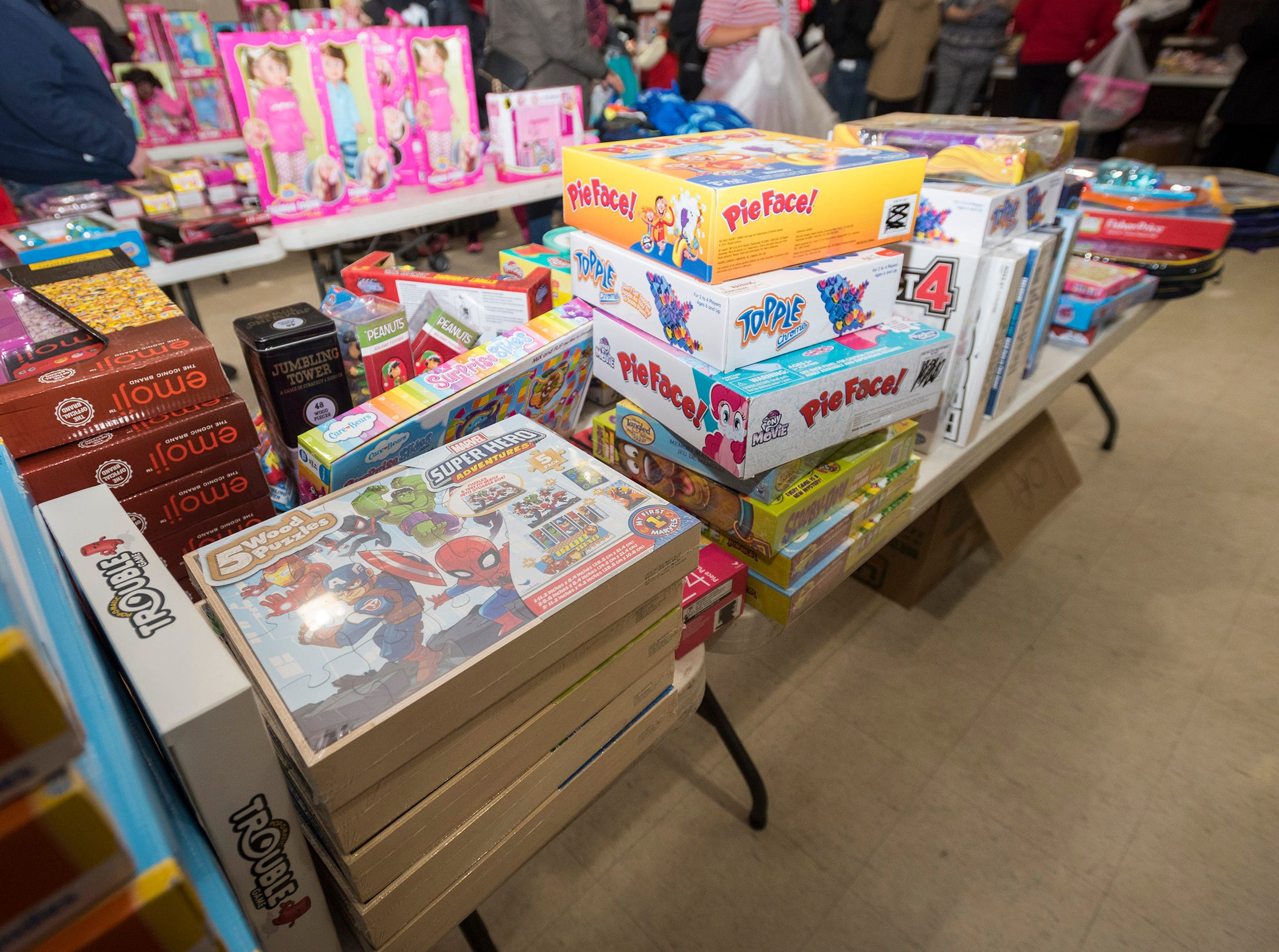 Different toys are stacked on tables Wednesday, Dec. 12, 2018 during the annual toy giveaway at the Charles Hammond American Legion Post in Port Huron.