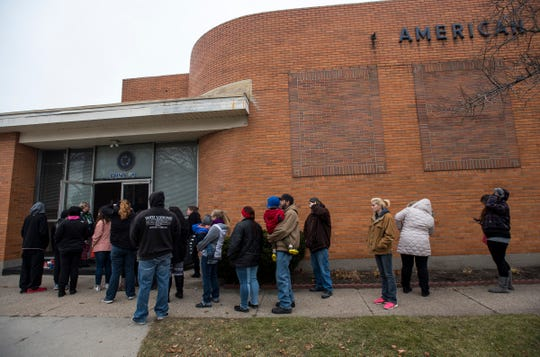 People line up to enter the Charles Hammond American Legion Post Wednesday, Dec. 12, 2018 during the annual toy giveaway.