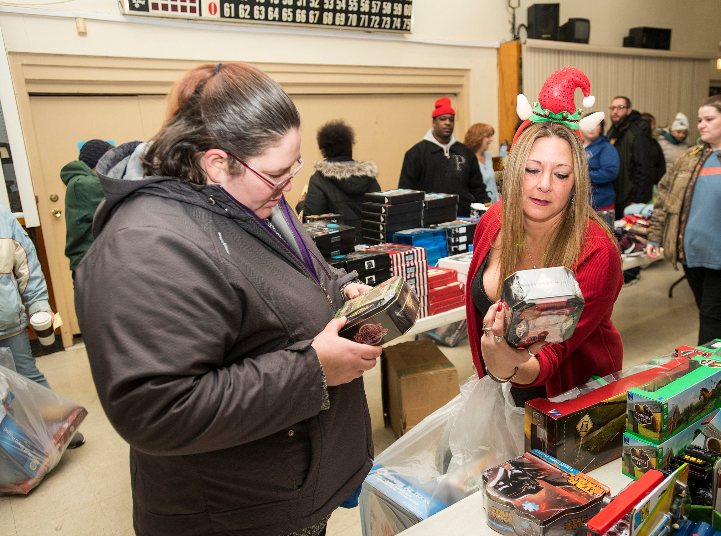 Toys For Kids Boardmember Jen Ousley, right, helps Analisa Jex find toys for her kids Wednesday, Dec. 12, 2018 during the annual toy giveaway at the Charles Hammond American Legion Post in Port Huron.