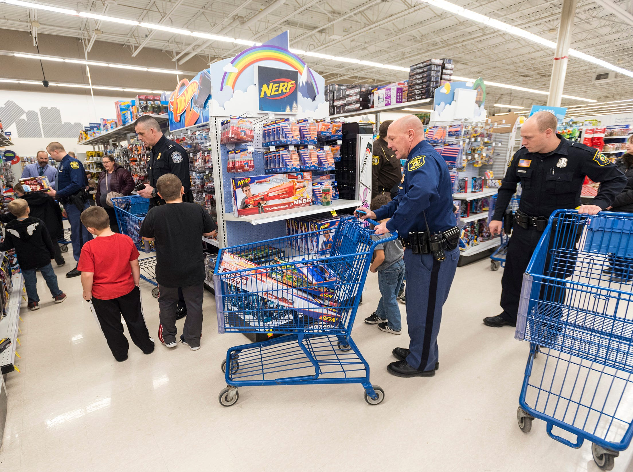 Officers from local agencies help kids with their Christmas shopping at Christmas with a Cop Tuesday, Dec. 11, 2018 at Meijer in Fort Gratiot.