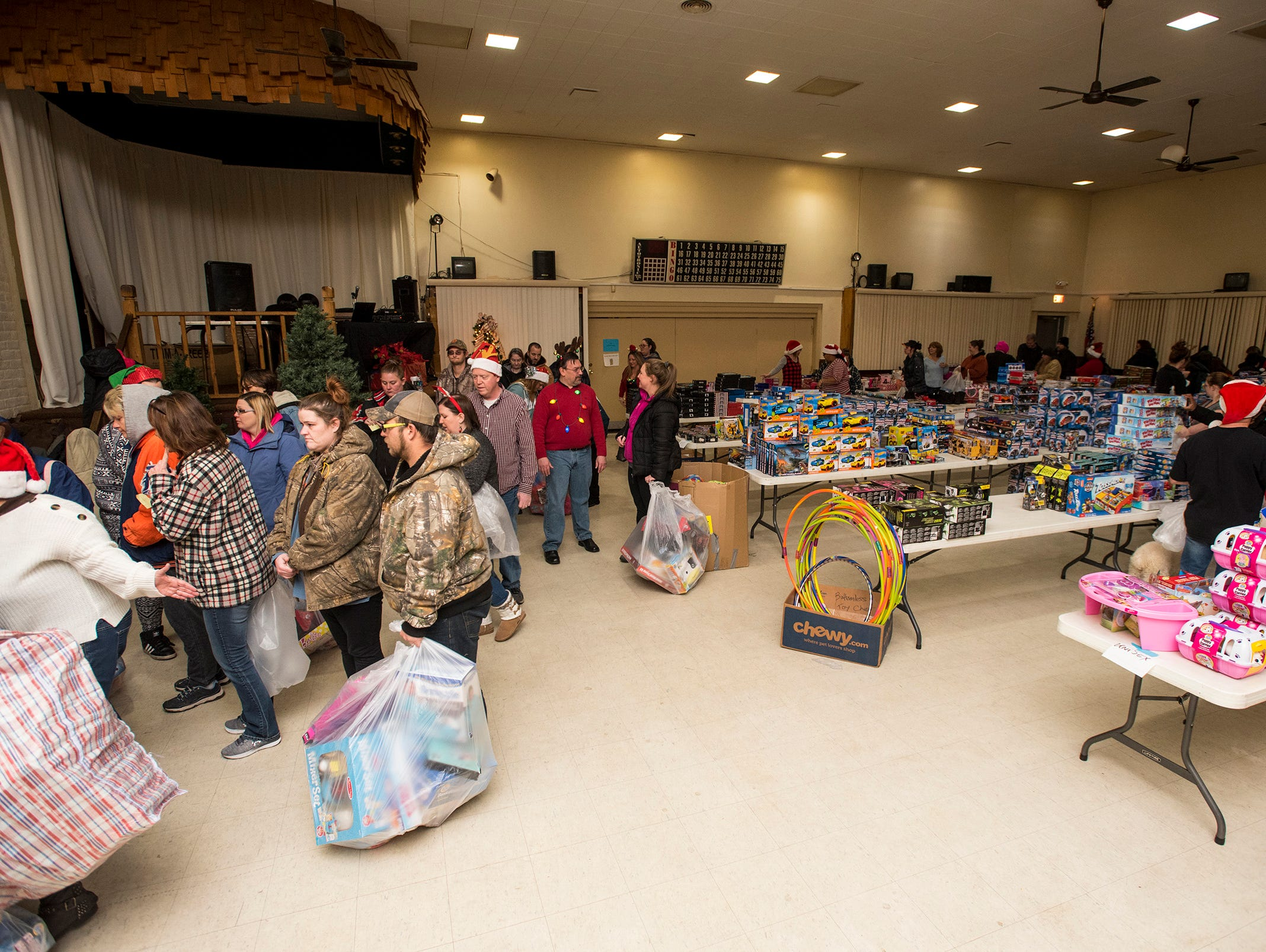 People line up to receive stocking stuffers Wednesday, Dec. 12, 2018 during the annual toy giveaway at the Charles Hammond American Legion Post in Port Huron.