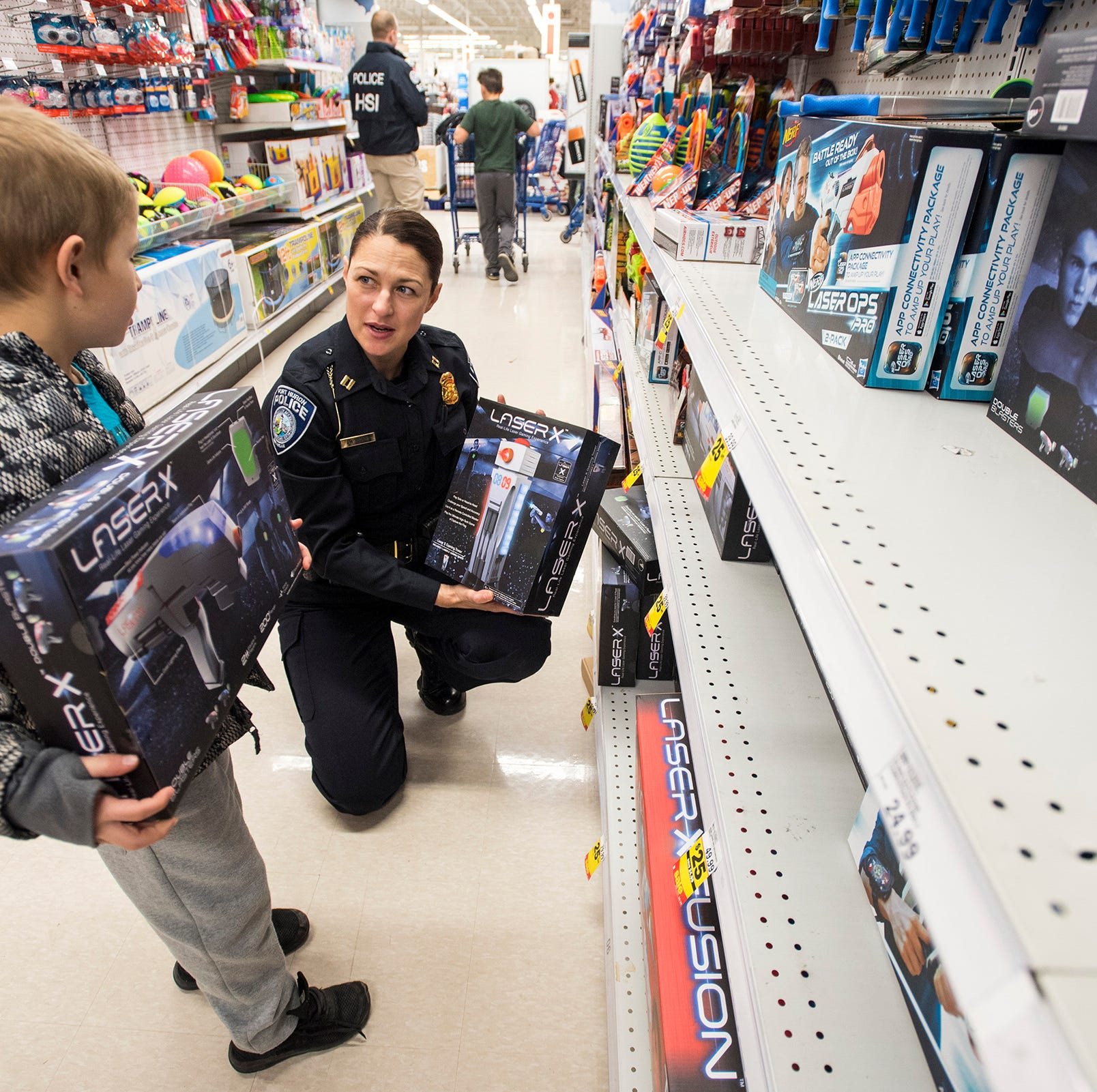 Cops bring Christmas to nearly 100 kids