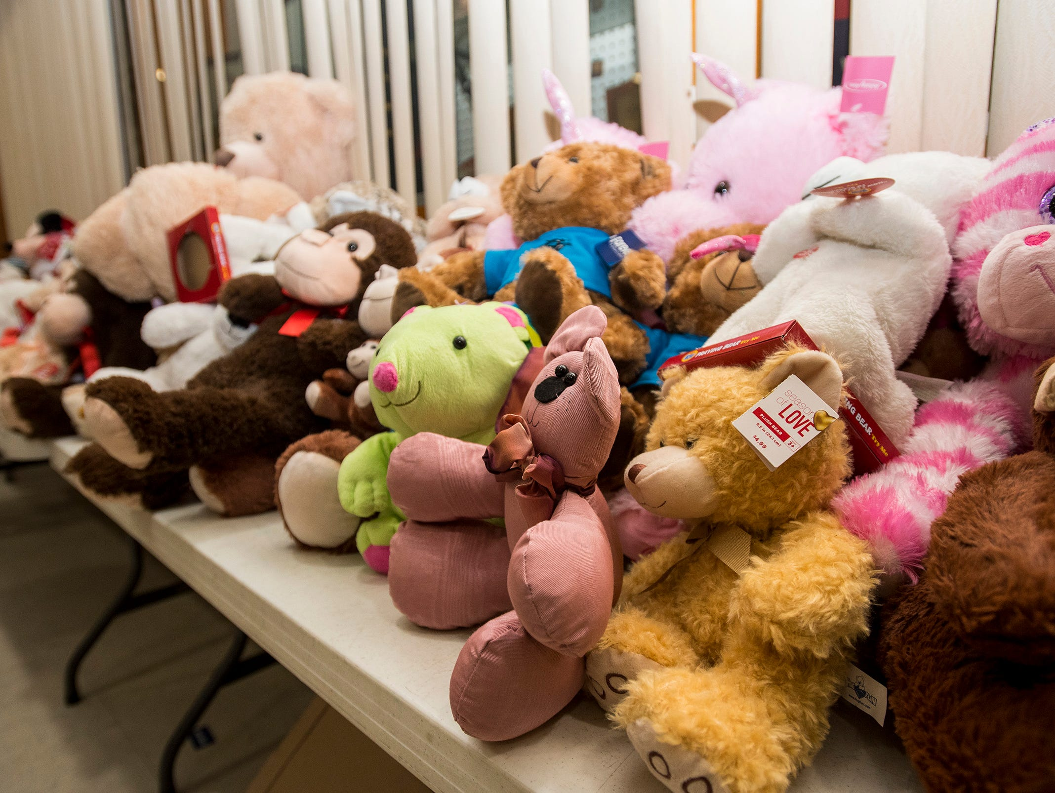Stuffed animals are stacked on a table Wednesday, Dec. 12, 2018 during the annual toy giveaway at the Charles Hammond American Legion Post in Port Huron.