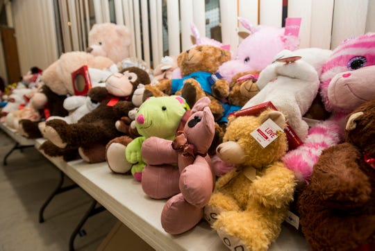 Stuffed animals are stacked on a table for Toys for Kids in this 2018 file photo.