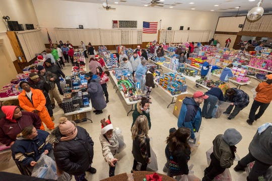 People fill the Charles Hammond American Legion Post in Port Huron Wednesday, Dec. 12, 2018 during the annual toy giveaway.