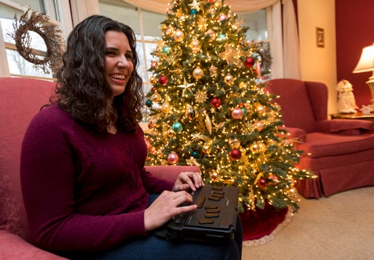 Alexandra Allers, 18, talks while operating a refreshable Braille reader Wednesday, Dec. 12, 2018 in her family's home in Fort Gratiot. Allers, who is a senior at Port Huron Northern, is blind and hopes to become a lawyer.