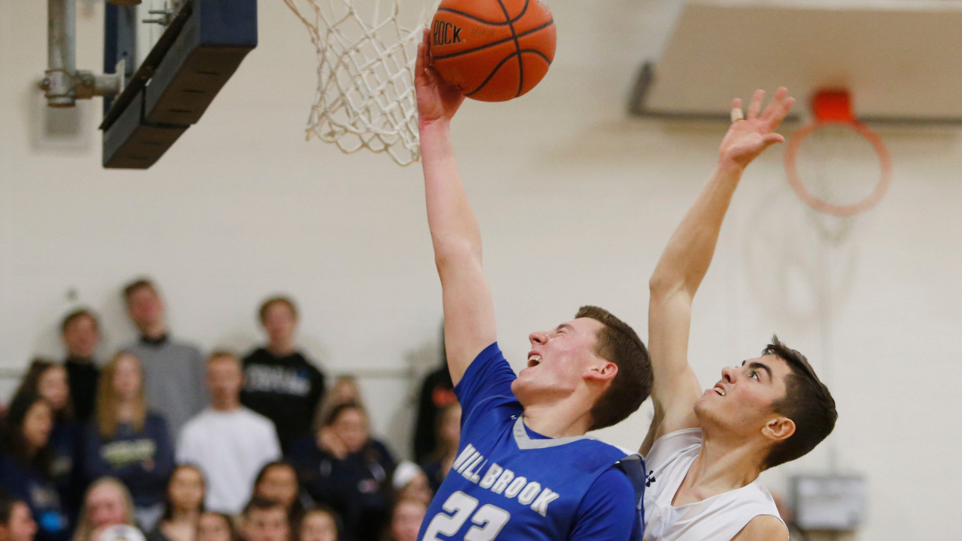 Millbrook's Patrick Kyle goes for a layup as he is covered by Highland's John Scalo during Tuesday's game in Highland on December 11, 2018.