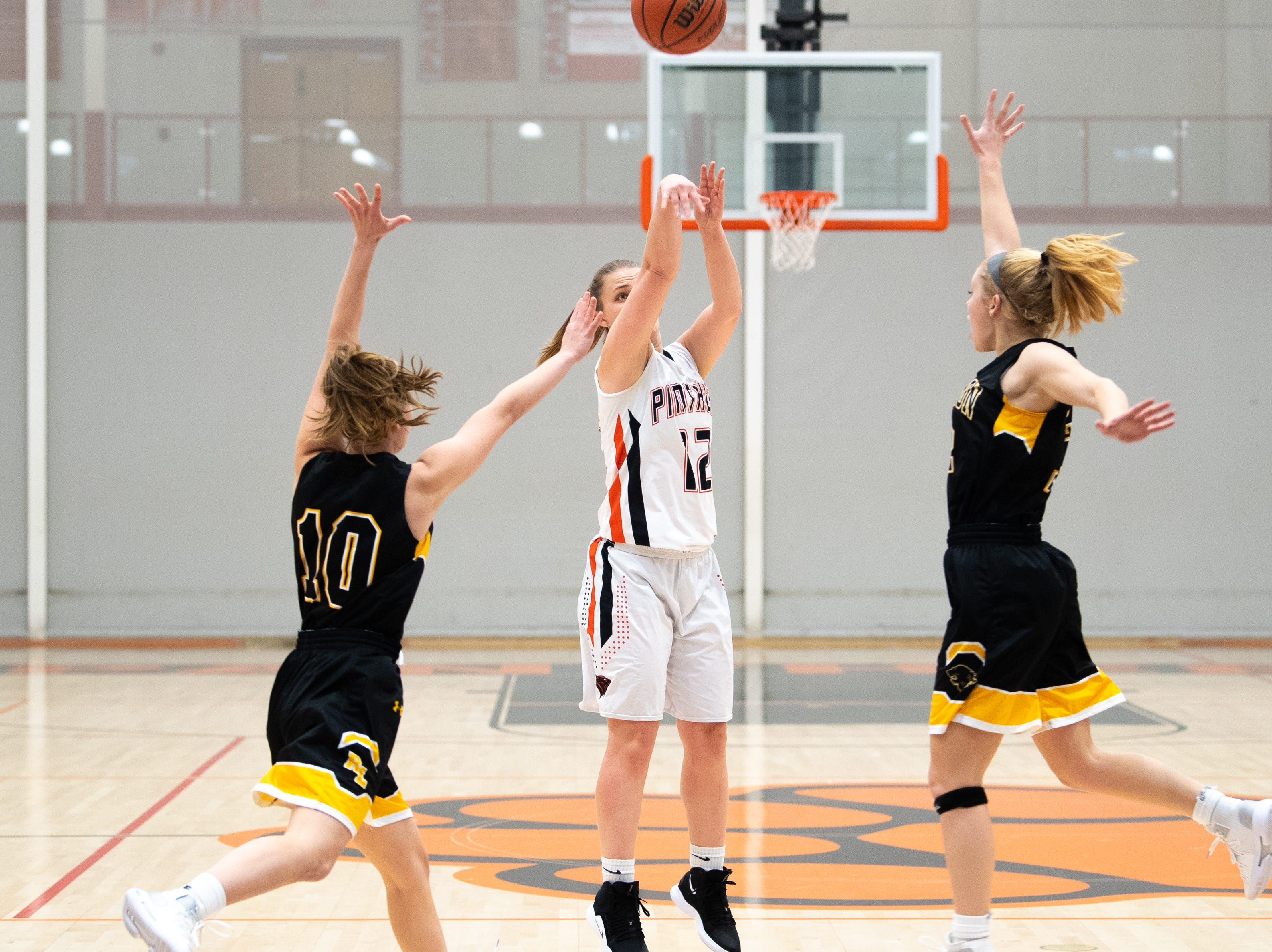 Katie Fabbri (12) puts up the three during the girls' basketball game between Central York and Red Lion at Central York, Tuesday, December 11, 2018. The Panthers defeated the Lions 40-38.
