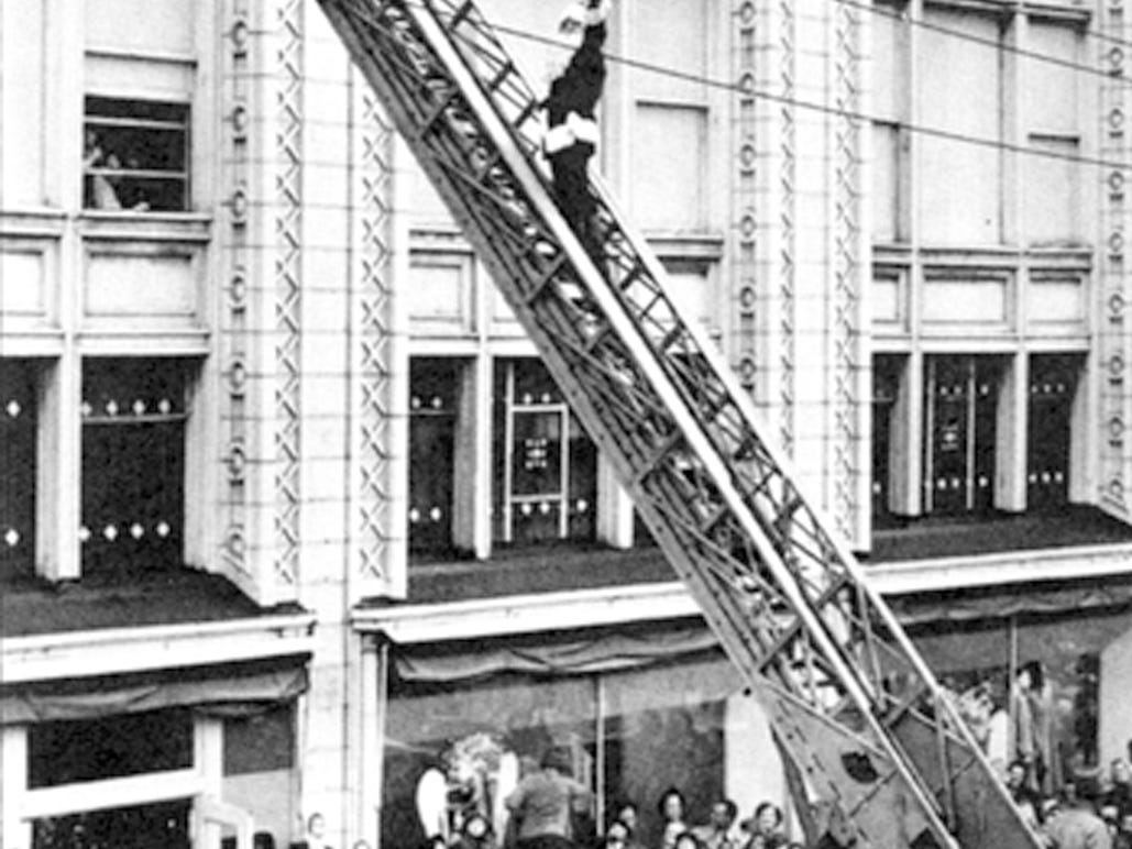 This photo captures the excitement of the downtown holiday shopping season in post-World War II York. Santa climbs up a ladder on his annual visit to the Bon-Ton.