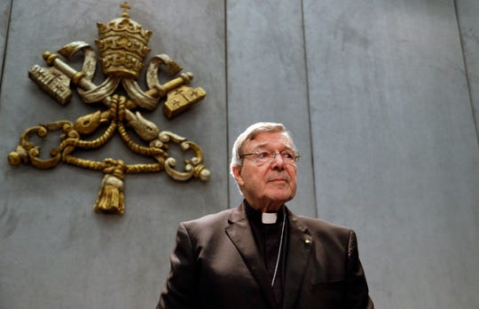 FILE - In this Thursday, June 29, 2017. file photo, Cardinal George Pell prepares to make a statement, at the Vatican. Pope Francis has removed two cardinals from his informal cabinet after they were implicated in the Catholic Church's sex abuse and cover-up scandal, shedding embarrassing advisers ahead of a high-stakes Vatican summit on abuse early next year. The Vatican said Wednesday, Dec. 12, 2018 that Francis in October had written to Chilean Cardinal Javier Errazuriz and Australian Cardinal George Pell thanking them for their five years of service on the so-called Group of Nine, or C-9. (AP Photo/Gregorio Borgia, File)