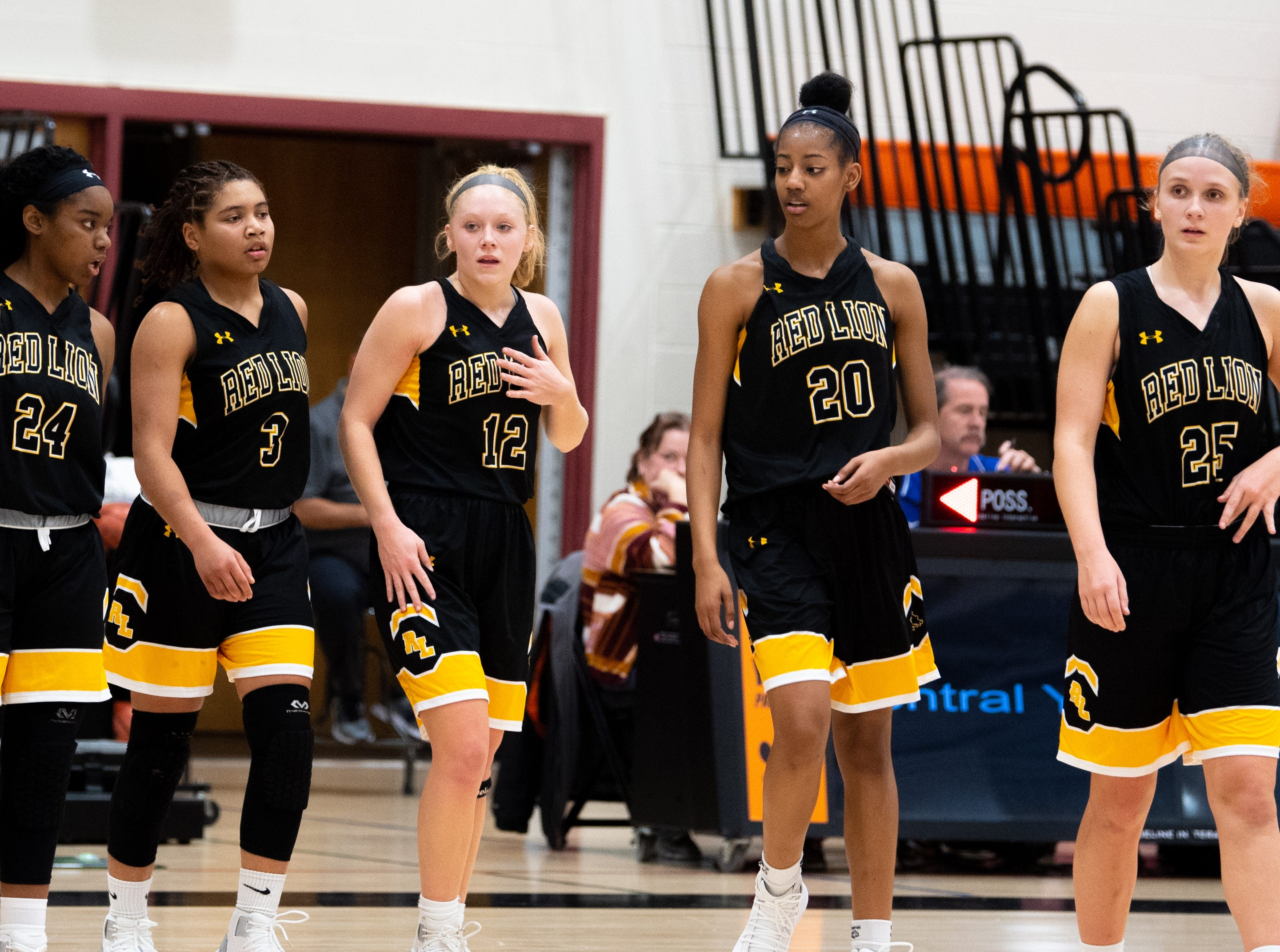 Jordyn Foster (24), Asia Eames (3), Paige Frey (12), Makiah Shaw (20), Julia Beiler (25) return to the floor after a time-out during the girls' basketball game between Central York and Red Lion at Central York, Tuesday, December 11, 2018. The Panthers defeated the Lions 40-38.