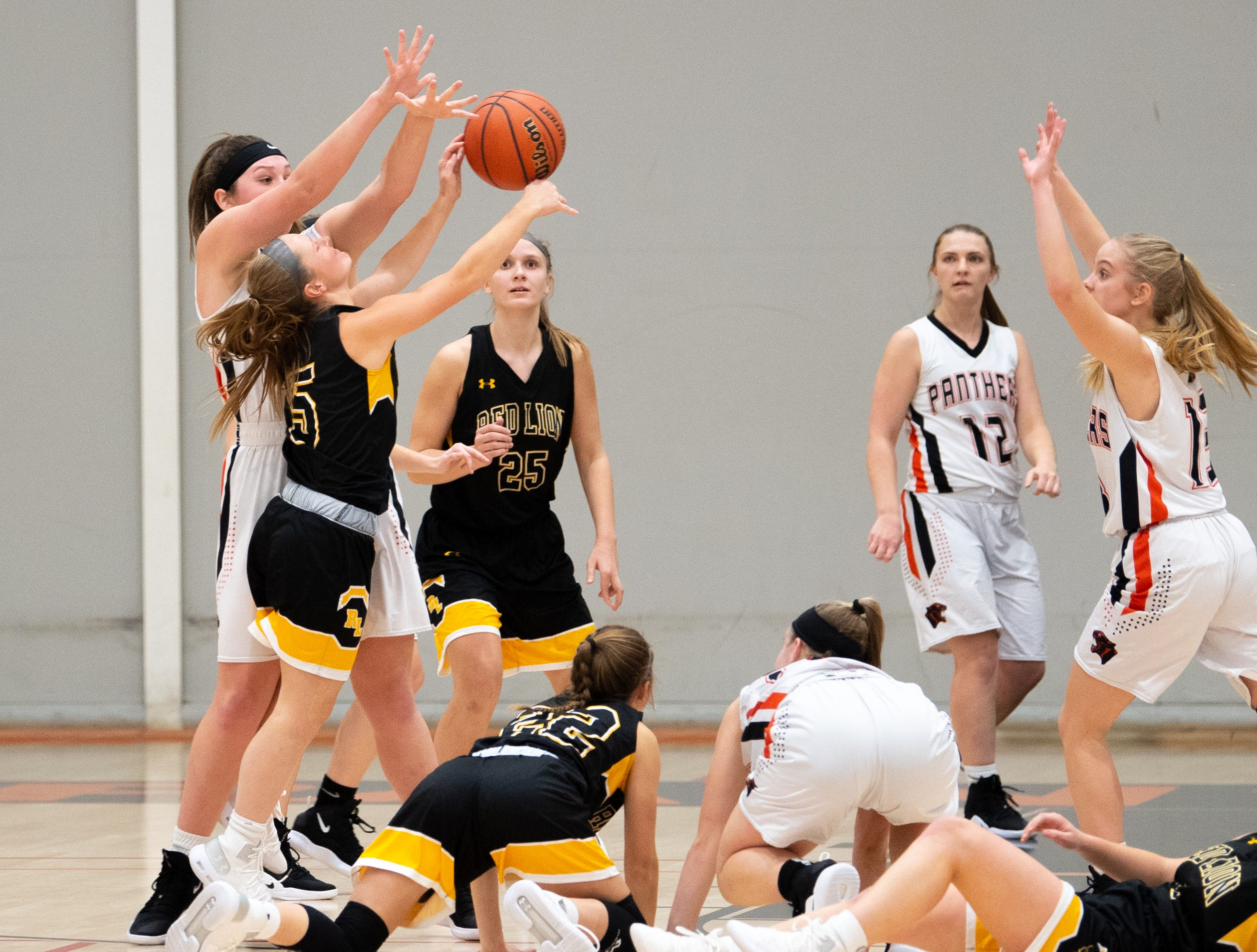 Emily Tollinger (5) of Red Lion throws up a last second shot during the girls' basketball game between Central York and Red Lion at Central York, Tuesday, December 11, 2018. The Panthers defeated the Lions 40-38.