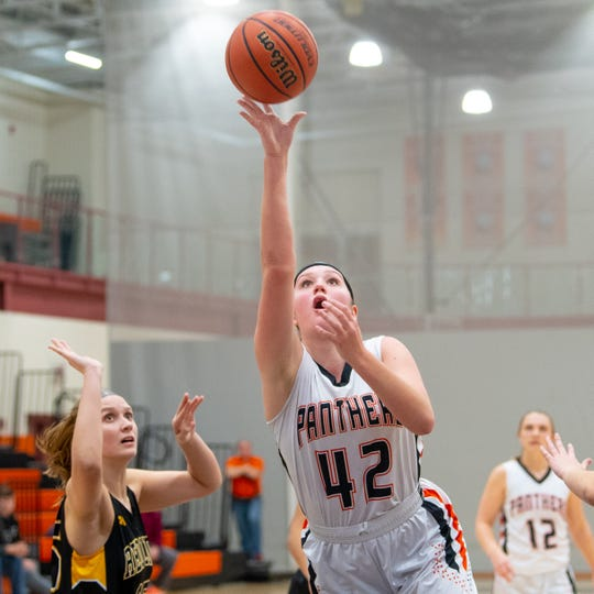 Emily Prowell (42) throws up the shot during the girls' basketball game between Central York and Red Lion at Central York, Tuesday, December 11, 2018. The Panthers defeated the Lions 40-38.