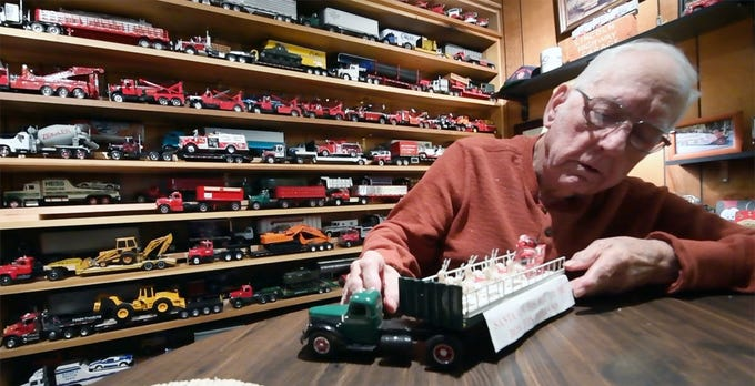 "Charles Klinefelter, of East Manchester Township, built a model of the trailer that brought Santa to The Bon-Ton in 1946. He rode inside the cab of the 1946 International truck with his father, Dave, the day Santa ""landed"" at the York Airport on Roosevelt Avenue. The truck and trailer then rode Santa and the sleigh to The Bon-Ton on South Beaver Street in York, where Santa climbed a ladder truck to Toyland."
