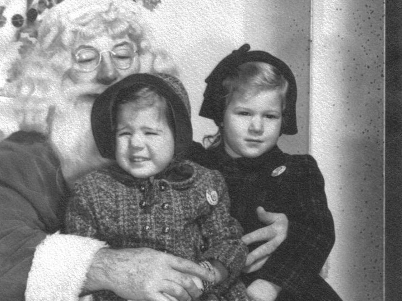 "Beth Watkins, of York Township, of her and her sister, Cindy with Santa in 1959 at the Bon-Ton.  Beth states, ""I would have been 2 and my sister, Cindy, would have been 3 1/2.  Of course, I do not remember the actual photo/visit with Santa, but Mom confirmed the year with me and that our outfits (coats/leggings and matching hats) came from Conners, a children's store on West Market Street. Our Nanna Thomas bought the outfits for us, according to Mom.  This photo is really special to me these last several years, because we lost my sister Cindy to cancer in 2003, so the photo has been put out every holiday season since."""