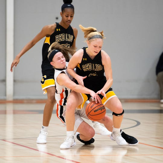 Paige Frey (12) of Red Lion draws a foul during the girls' basketball game between Central York and Red Lion at Central York, Tuesday, December 11, 2018. The Panthers defeated the Lions 40-38.